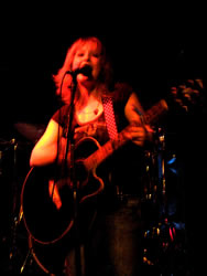 Mary Pascoe playing guitar at the Whisky